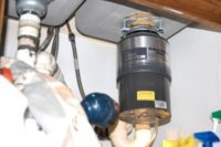 garbage disposal , in sink erator, kitchen appliance