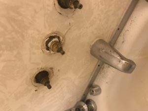 Rusted shower before its repaired by a victorville plumber