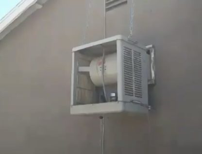 Evaporative cooler with panels removed